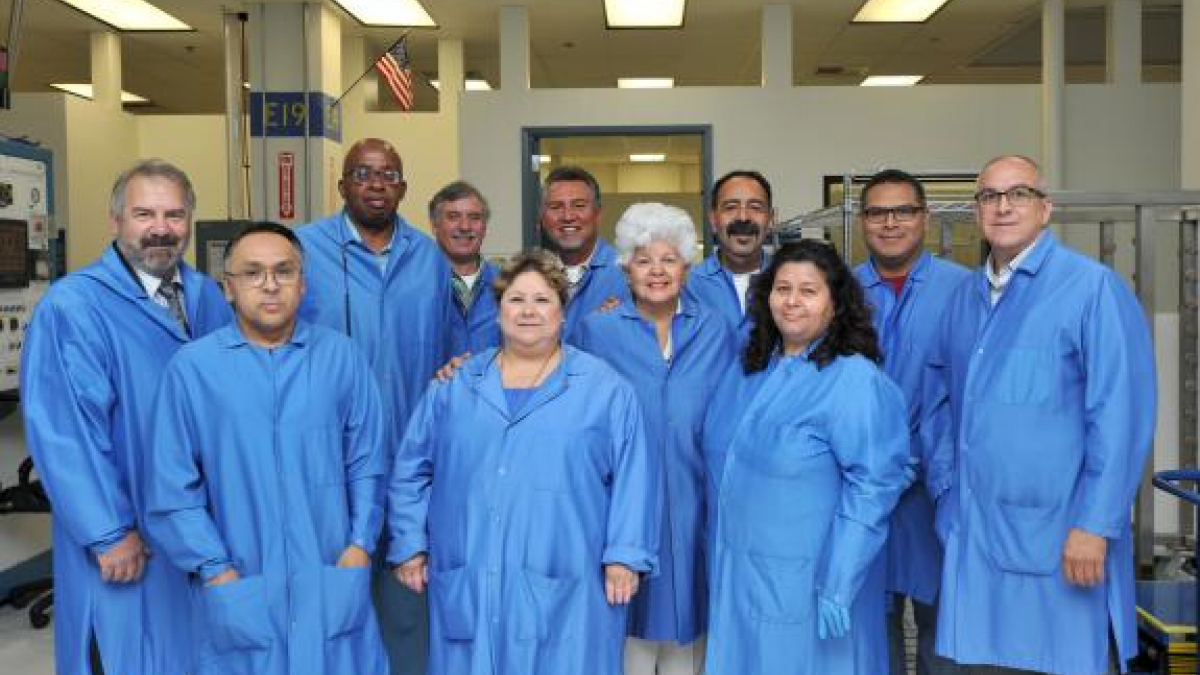 Rep. Grace Napolitano joins the Manufacturing, Inspection and Engineering support staff for a group photo while on tour of the Manufacturing and Assembly Facility at the Northrop Grumman Azusa campus