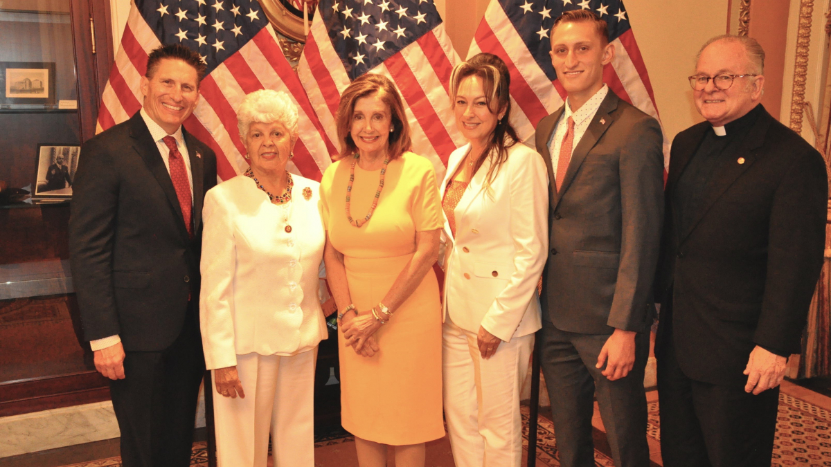 Pictured from left to right: Pastor Kevin Yriarte; Rep. Grace F. Napolitano; Speaker of the House, Nancy Pelosi; Geanene Yriarte; Ryder Yriarte; and House of Representatives Chaplain, Father Patrick J. Conroy