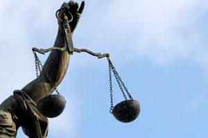 Statue of person holding scales of justice