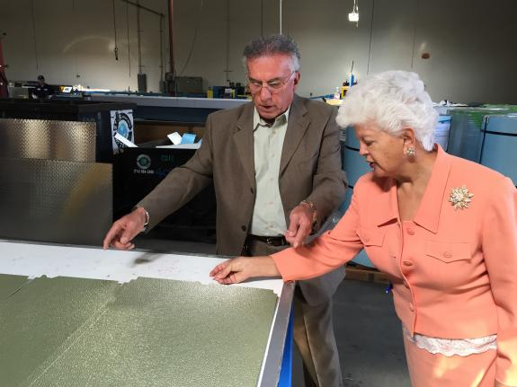 Commercial Cooling CEO John Milani shows Rep. Napolitano wall panels used in the manufacturing of refrigerators and freezers.